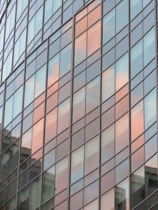 Urban Pastels - the late day sky reflected in the windows of a downtown condo in Providence, R.I.
